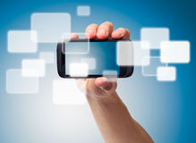 Hand and Multimedia phone Stock Image