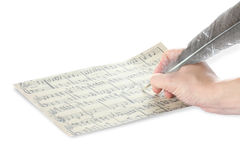 Hand and music sheet Stock Images
