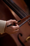 Hand musician playing contrabass Stock Photography