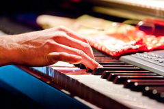 Hand of musician playing keyboard Royalty Free Stock Photos