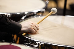 The hand of a musician playing on a timpani Royalty Free Stock Image