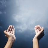Hand Of Muslim People Praying. Hand of muslim people with praying gesture praying facing sky Royalty Free Stock Photography