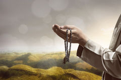 Hand of muslim people praying. With hill landscape background Royalty Free Stock Photography