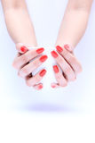 Hand with nail red Stock Photos