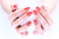 Hand with nail red Stock Images