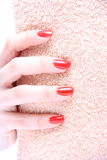 Hand with nail red Royalty Free Stock Images
