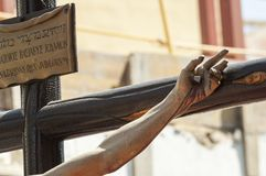 Free Hand Nailed To The Cross Of The Sculpture Of The Crucified Chris Stock Photo - 110079250