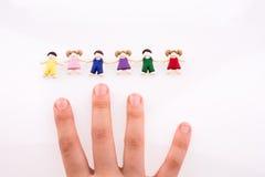 Hand near figures Stock Photo