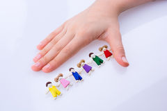Hand near figures Royalty Free Stock Photography