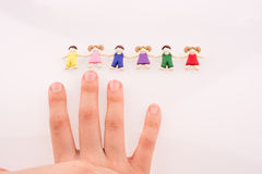 Hand near figures Stock Images