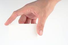 Hand nehmen eine weiße Karte Stockfotos