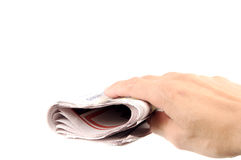 Hand and Newspaper Stock Photos