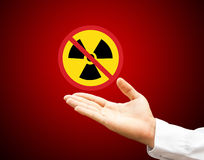 Hand and no nuclear. On red background Royalty Free Stock Image