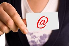 Hand with note. The picture shows the hand of a woman with the note with email sign royalty free stock photos