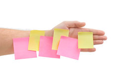 Hand and note paper Royalty Free Stock Photography