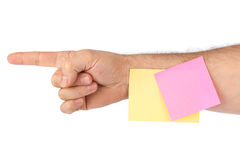 Hand and note paper Stock Image