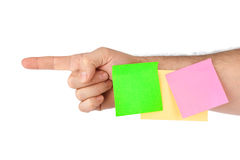 Hand and note paper Royalty Free Stock Images