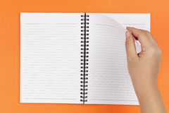 Hand and notebook Stock Photography