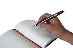 Hand and notebook. Hand writing in a notebook on white background royalty free stock photos