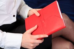 Hand and notebook. Close up Royalty Free Stock Photos
