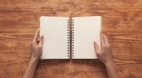 Hand notebook wooden background stock photos