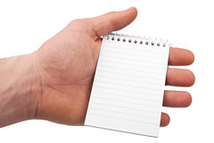 Hand with notepad 1 Royalty Free Stock Images