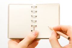 Hand and notepad Royalty Free Stock Photo
