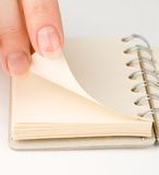 Hand and notepad Stock Photography