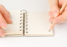 Hand and notepad Royalty Free Stock Image