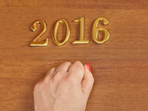 Hand and numbers 2016 on door - new year background Royalty Free Stock Photo