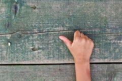Hand, nummer och trä Royaltyfria Foton