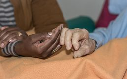 Hand of nurse holding a senior woman. Concept of helping hands, care for the elderly.  Stock Images