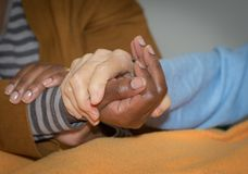 Hand of nurse holding a senior woman. Concept of helping hands, care for the elderly.  royalty free stock photos