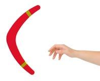 Hand och bumerang Arkivfoto