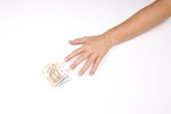 Hand och bunt av euro Arkivbild