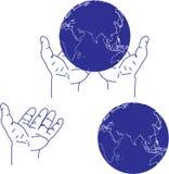 Hand och jordklot Arkivfoton