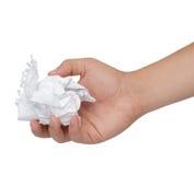 Hand och skrynkligt papper som isoleras på vit Royaltyfri Fotografi
