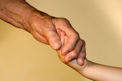 Hand od grandmother and grandchild Stock Images
