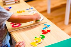 Free Hand Of 2 Year Old Boy In Elementary Class Using A Toy To Develop Motor Skills Royalty Free Stock Photo - 167070005