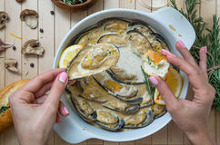Hand Of A Person Holding Baked Mussel Royalty Free Stock Photo