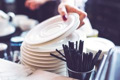 Hand Of Bartender With Saucers And Plastic Straws Royalty Free Stock Photography