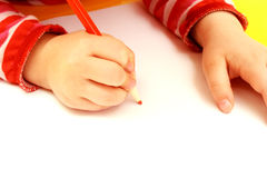 Hand Of Child Drawing On A Paper Royalty Free Stock Image