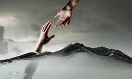 Hand Of Person Drowning In Water Stock Images