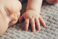Free Hand Of Sleeping Baby Close Up On The Bed Stock Image - 179219881