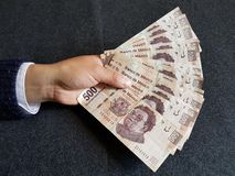 Free Hand Of The Man Holding Mexican Banknotes When Making A Payment Stock Photography - 120732042