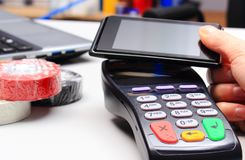 Free Hand Of Woman Paying With Credit Card Reader And Mobile Phone With NFC Technology Royalty Free Stock Image - 124746886
