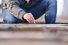 Hand Of Young Man How Wants To Extinguish Cigarette On A Old B Stock Image