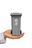 Hand offer gray trash can Stock Photography