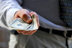 Hand offer money Stock Photos