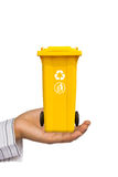 Hand offer yellow trash can Royalty Free Stock Photo